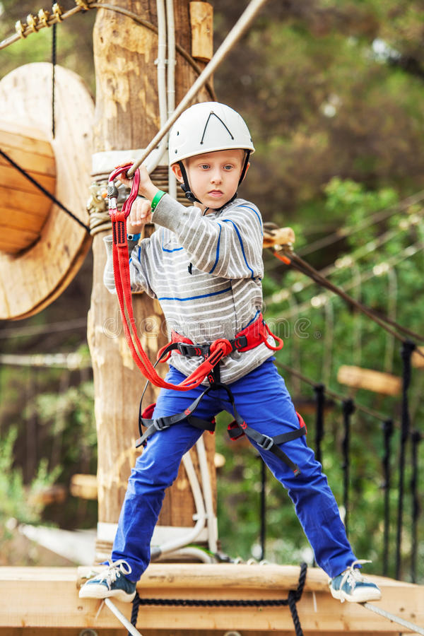 Concentrated little Boy on the rope track royalty free stock images