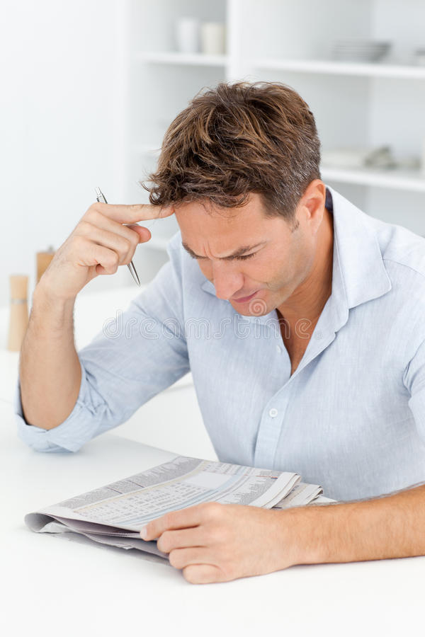 Download Concentrated Man Doing A Cryptic Crossword Royalty Free Stock Photo - Image: 17376985