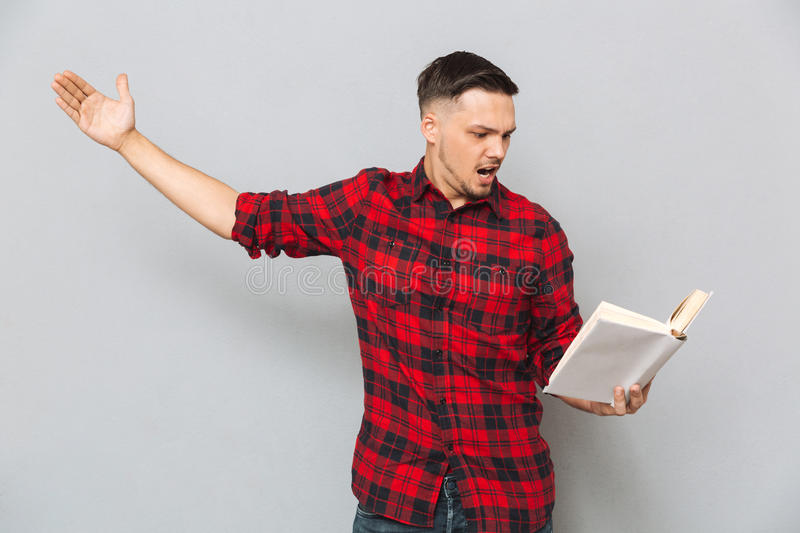 Concentrated man rehearses with book stock photography