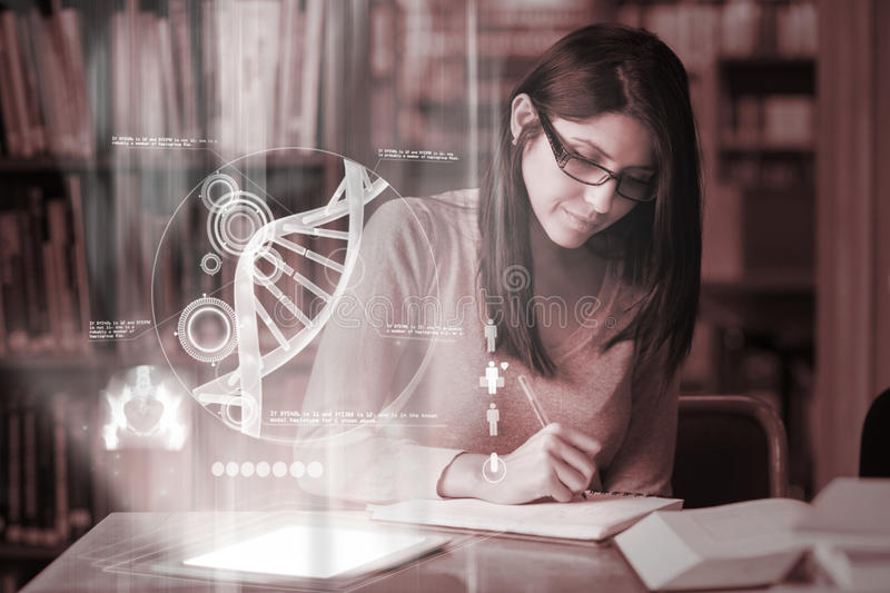 Concentrated mature student studying medicine on digital interface. In university library royalty free stock image
