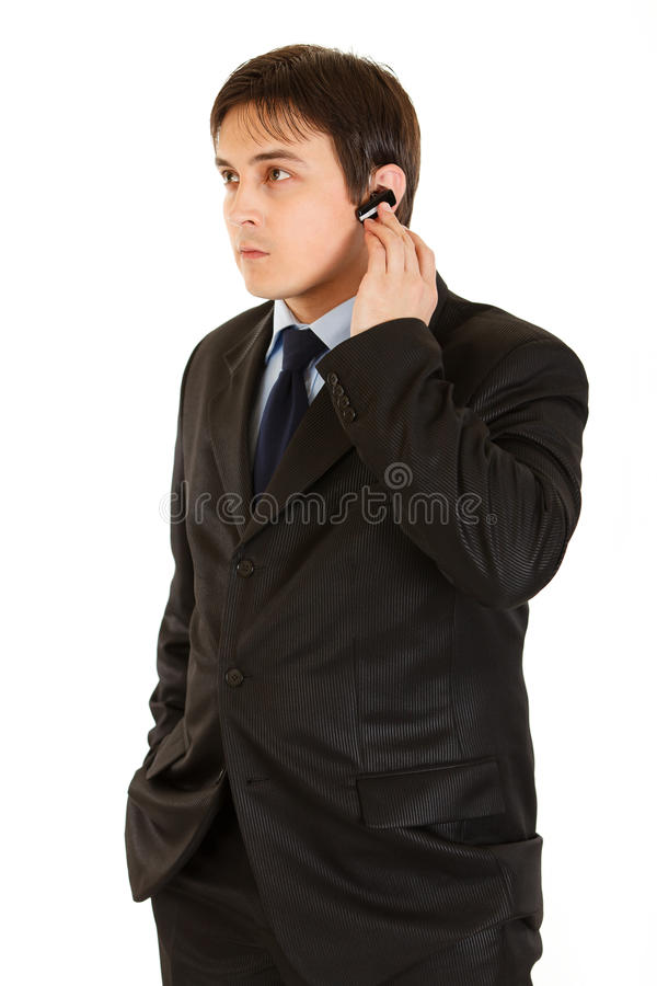 Download Concentrated Modern Businessman With Handsfree Stock Image - Image: 18994365