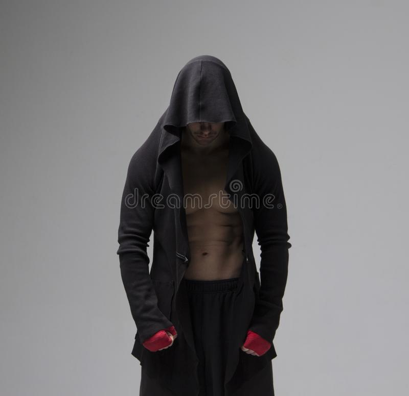 Concentrated prepared fighter man in sportswear looking down. Studio shot royalty free stock images