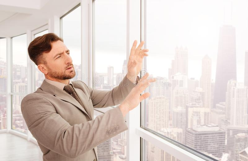 Concentrated professional businessman standing in the office royalty free stock photo