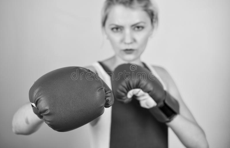 Concentrated on punch. Woman boxing gloves focused on attack. Ambitious girl fight boxing gloves. Female rights. I am royalty free stock photos