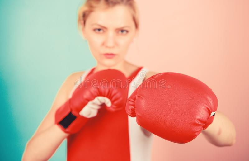 Concentrated on punch. Woman boxing gloves focused on attack. Ambitious girl fight boxing gloves. Female rights. I am stock photo