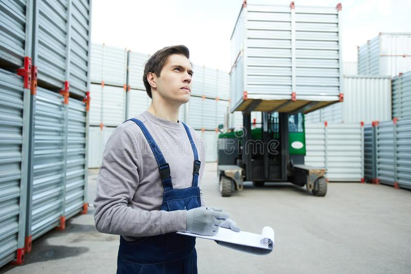 Concentrated storage worker controlling loading stock photo