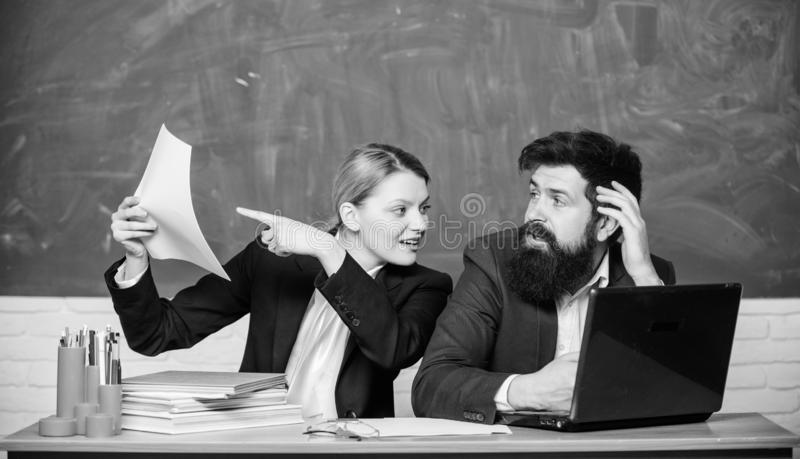 Concentrated on studying. teacher and student on exam. business couple use laptop documents. businessman and secretary stock photo