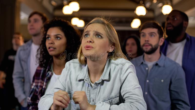 Concentrated team supporters waiting for goal, sport fans entertainment, joy royalty free stock image