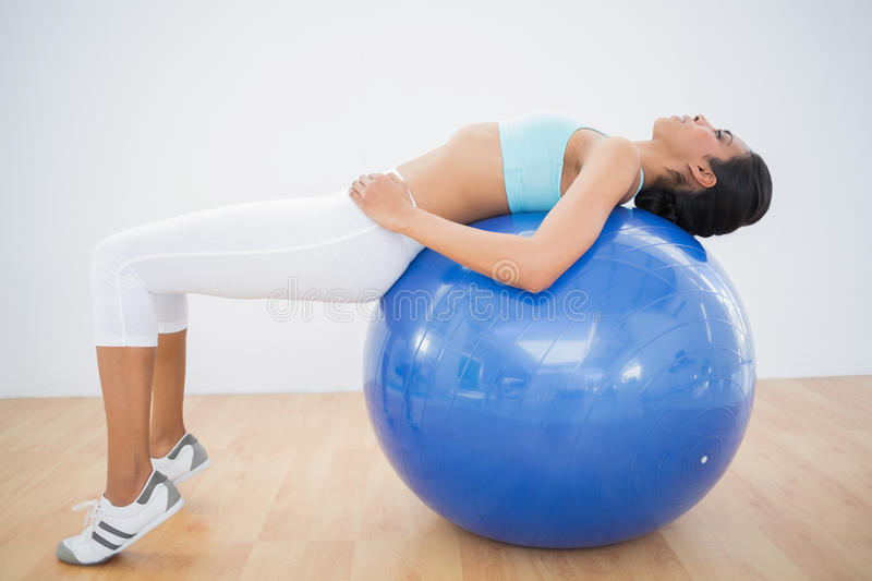 Download Concentrated Toned Woman Training On Fitness Ball Stock Image - Image of exercise, length: 35021171