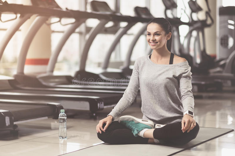 Concentrated woman enjoying yoga after hard workout royalty free stock photos