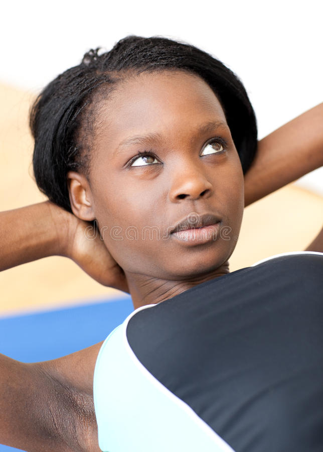 Download Concentrated Woman In Gym Clothes Excercising Royalty Free Stock Photo - Image: 13766205