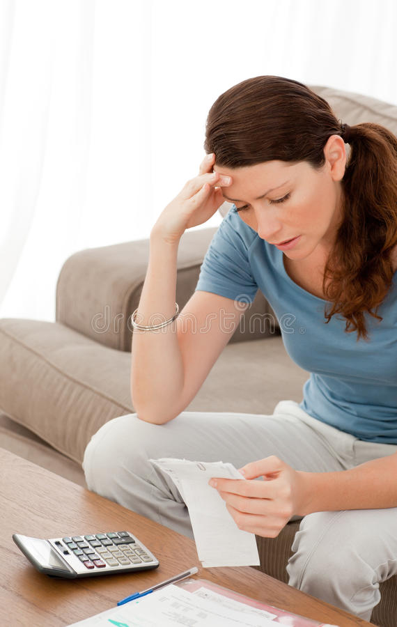 Download Concentrated Woman Looking At Her Bills Stock Image - Image: 17279107
