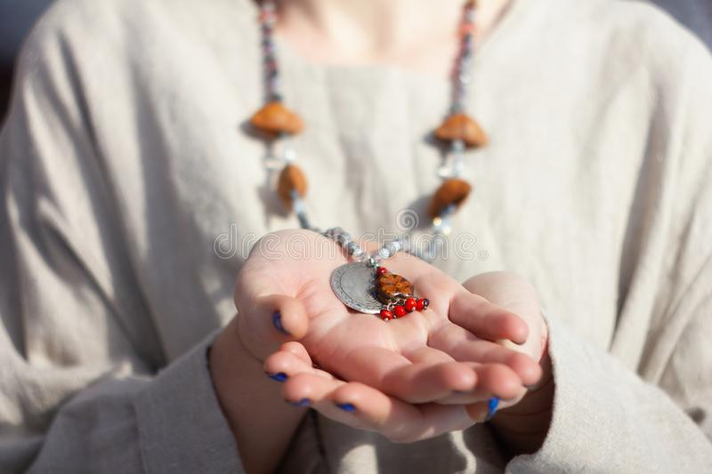 Concentrated woman wearing rosary beads. Close up stock photography