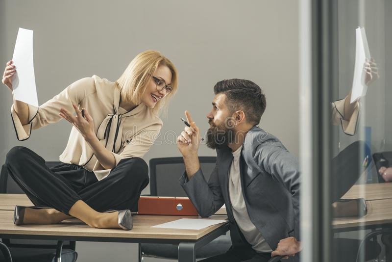 Concentrated on work. Businesswoman and businessman write business plan. Busy day in office. Sensual woman and bearded. Concentrated on work. Businesswoman and royalty free stock photos