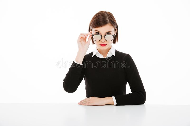 Concentrated young business woman wearing glasses royalty free stock photo
