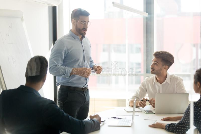 Business coach giving presentation to young team royalty free stock image