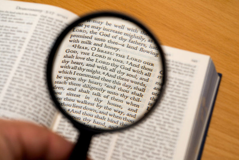 Concentrating on bible stock image