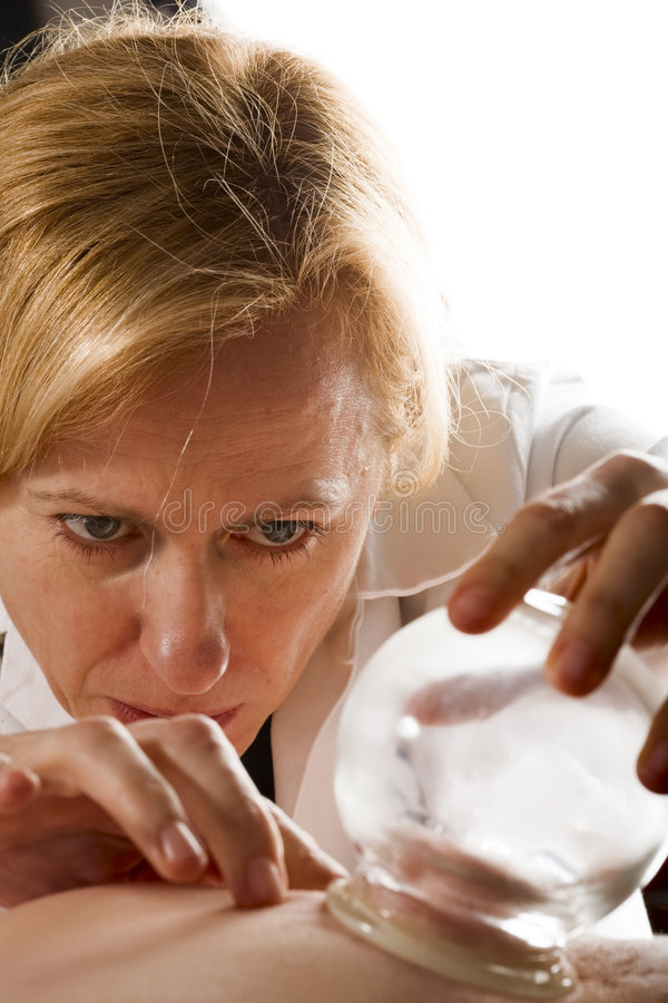 Download Concentrating While Vacuum Cupping Stock Photo - Image: 7240104