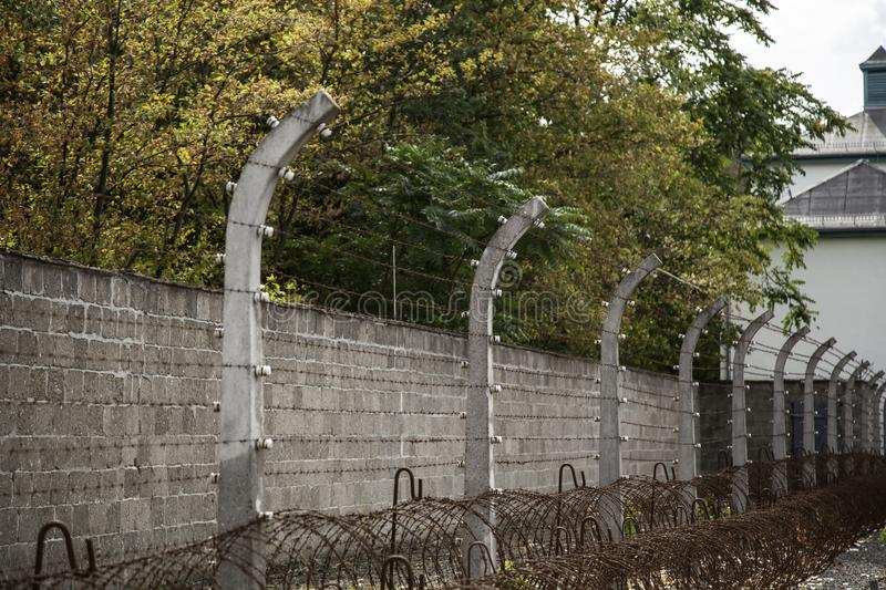 Concentration camp in Berlin. Detail of holocaust and extermination, green, landscape, tree, death, tourism, main, entrance, execution, metal, nazi, government royalty free stock image