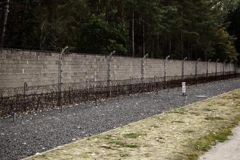 Concentration camp in Berlin. Detail of holocaust and extermination, green, landscape, tree, death, tourism, main, entrance, execution, metal, nazi, government royalty free stock photography