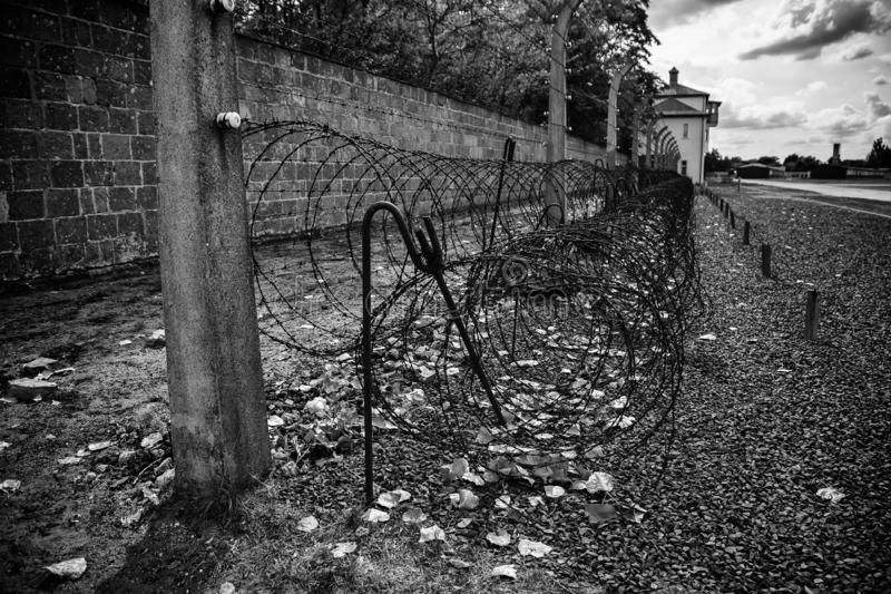 Concentration camp in Berlin. Detail of holocaust and extermination, green, landscape, tree, death, tourism, main, entrance, execution, metal, nazi, government royalty free stock photo