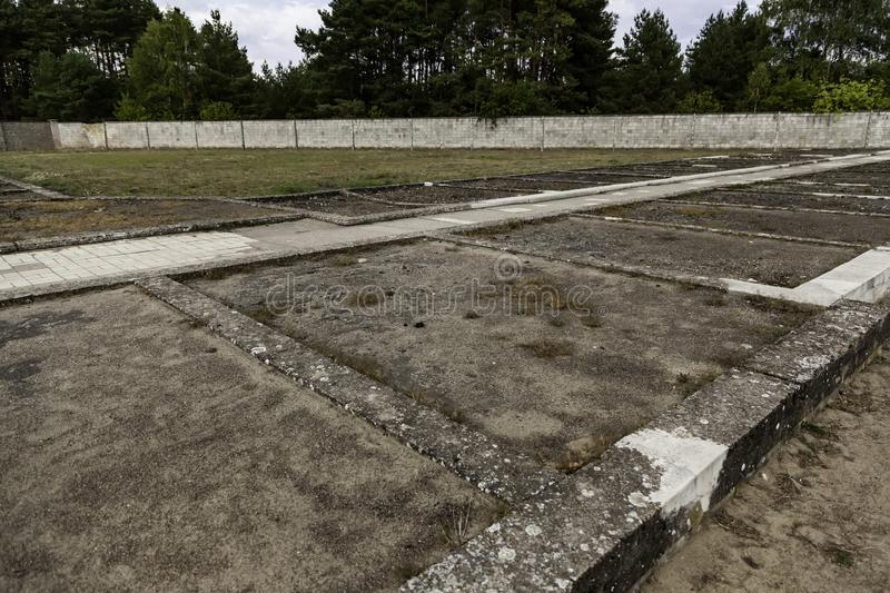 Concentration camp in Berlin. Detail of holocaust and extermination, green, landscape, tree, death, tourism, main, entrance, execution, metal, nazi, government royalty free stock images