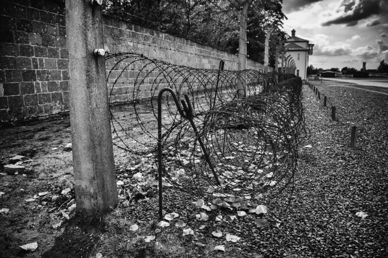 Concentration camp in Berlin. Detail of holocaust and extermination, green, landscape, tree, death, tourism, main, entrance, execution, metal, nazi, government stock photography