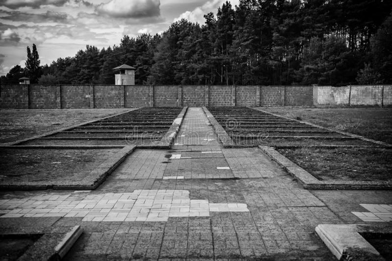Concentration camp in Berlin. Detail of holocaust and extermination, green, landscape, tree, death, tourism, main, entrance, execution, metal, nazi, government stock photo