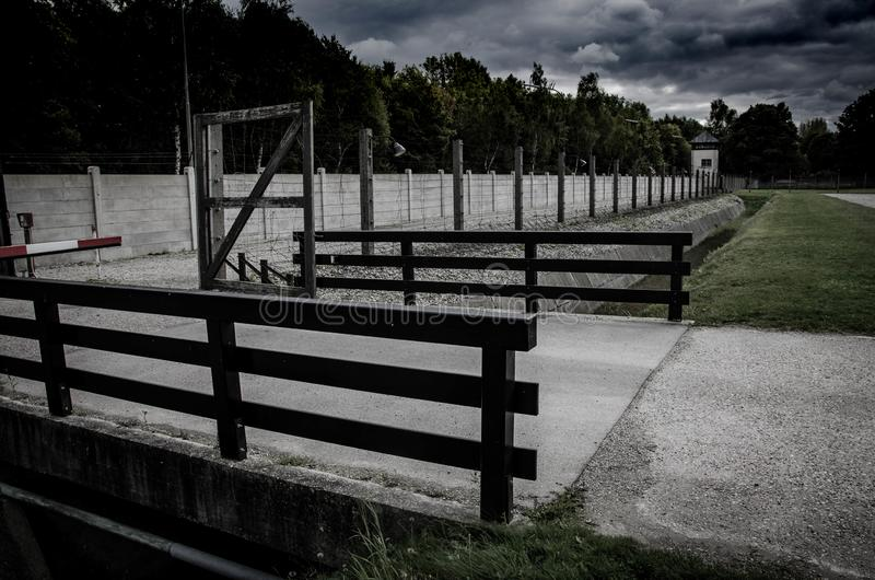 Concentration camp fence. Barbed wire net and electric fencing. Genocide, holocaust, world war, concentration camp themed design. Concentration camp fence stock photos