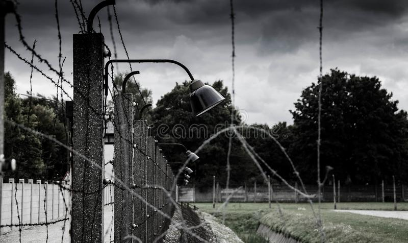Concentration camp fence. Barbed wire net and electric fencing. Genocide, holocaust, world war, concentration camp themed design. Concentration camp fence royalty free stock photography