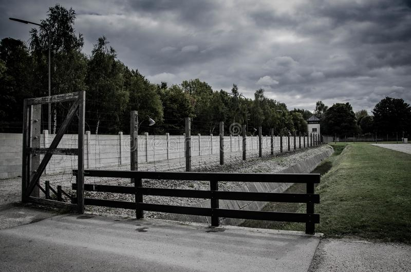 Concentration camp fence. Barbed wire net and electric fencing. Genocide, holocaust, world war, concentration camp themed design. Concentration camp fence royalty free stock images