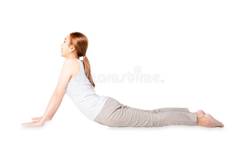 Concentrez calmement les exercices assez minces de yoga de forme physique de femme de sourire Yoga de pratique de jeune belle fil photo stock