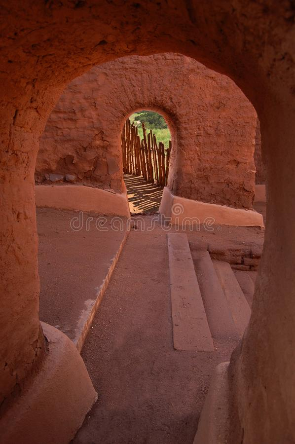 The Mission at Pecos National Monument. Concentric adobe archways within the ruins of the mission church located at the Pecos National Monument in New Mexico stock photography