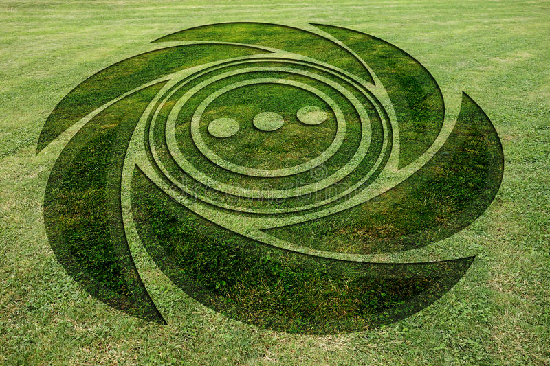 Concentric spiral circles fake crop circle meadow stock images