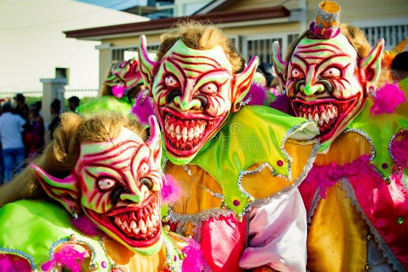 Closeup three men in scary clowns costumes pose for photo at dominican carnival. Concepcion De La Vega, DOMINICAN REPUBLIC - FEBRUARY 09, 2020: closeup three men stock images