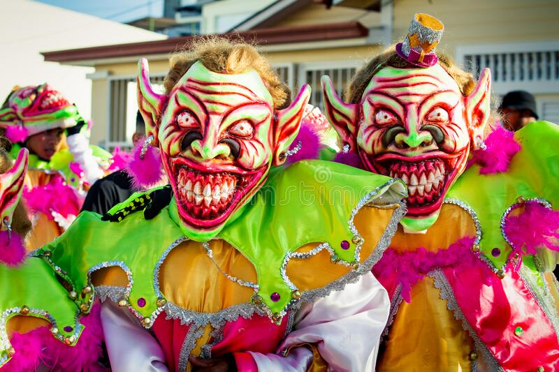 Closeup two men in scary clowns costumes pose for photo at dominican carnival. Concepcion De La Vega, DOMINICAN REPUBLIC - FEBRUARY 09, 2020: closeup two men in royalty free stock image