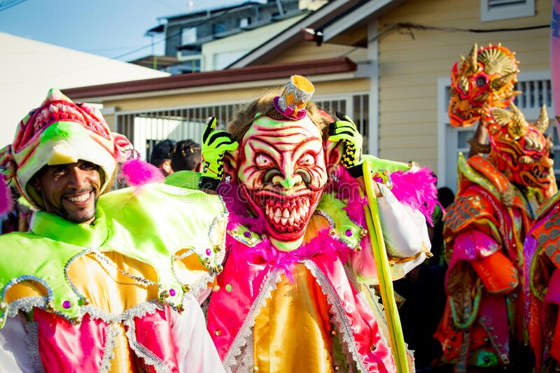 Group of men in scary clowns costumes poses for photo at dominican carnival. Concepcion De La Vega, DOMINICAN REPUBLIC - FEBRUARY 09, 2020: group of men in scary royalty free stock images
