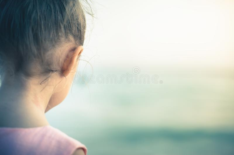 Concept, abstract image of beautiful little girl at the beach. Concept, abstract image of beautiful little girl at beach. Soft sea background. Traveling with stock photo