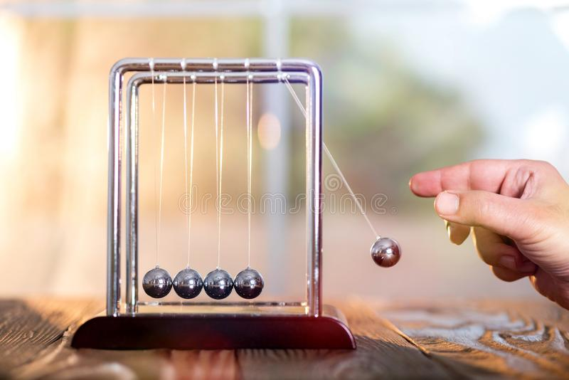 Concept For Action and Reaction in Business With Newton`s Cradle royalty free stock photos