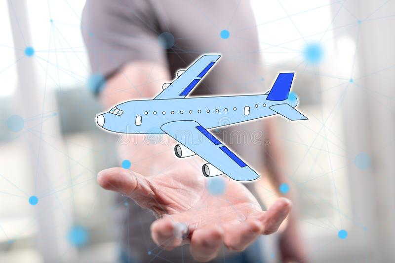 Concept of air transport. Air transport concept above the hand of a man in background stock photography