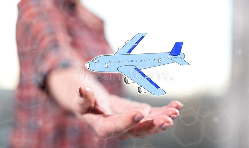 Concept of air transport. Air transport concept above the hand of a woman in background stock images