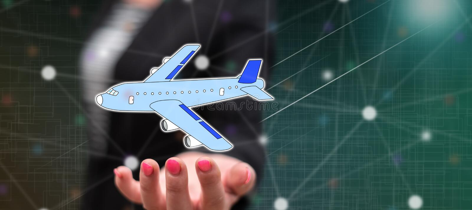 Concept of air transport. Air transport concept above the hand of a woman in background royalty free stock photo