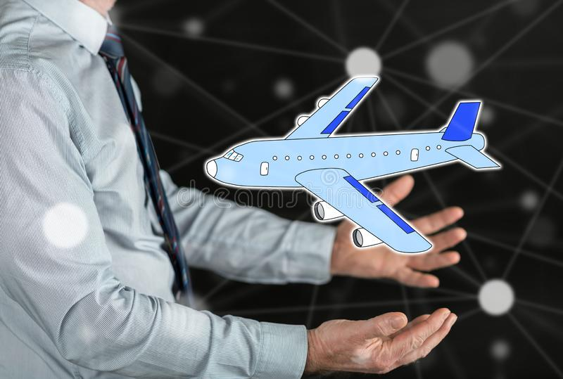 Concept of air transport. Air transport concept above the hands of a man stock photo