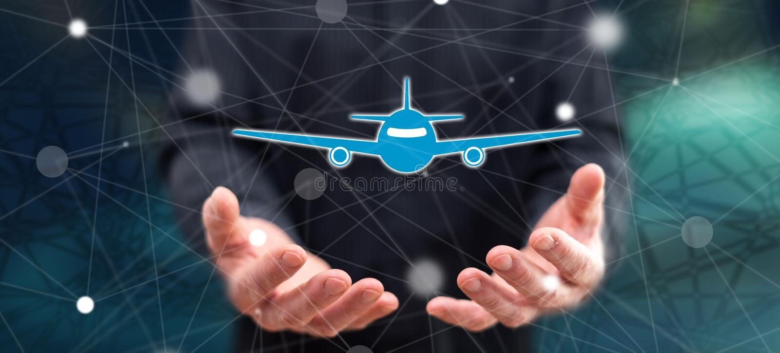 Concept of air transport. Air transport concept above the hands of a man in background royalty free stock image