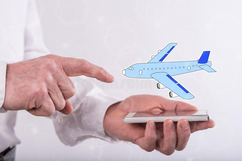 Concept of air transport. Air transport concept above a smartphone held by a man royalty free stock images
