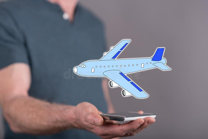 Concept of air transport. Air transport concept above a smartphone held by a man in background royalty free stock photos