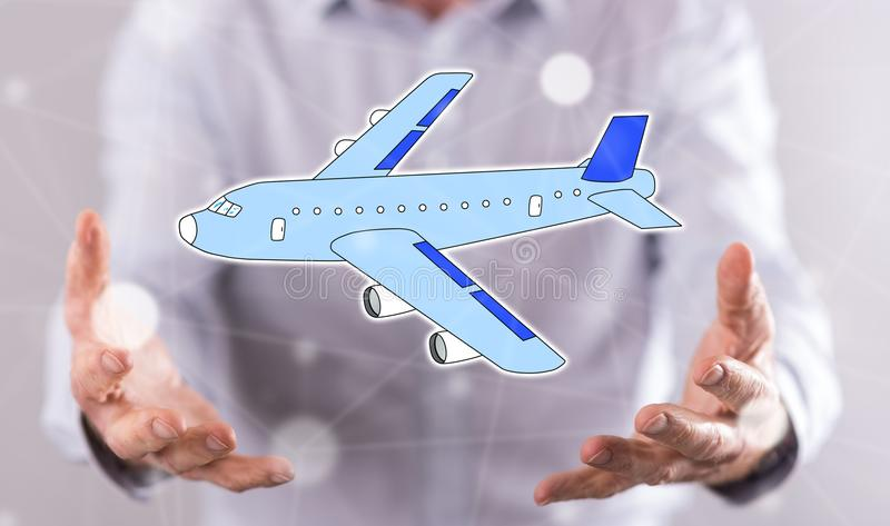 Concept of air transport. Air transport concept above the hands of a man in background stock photos