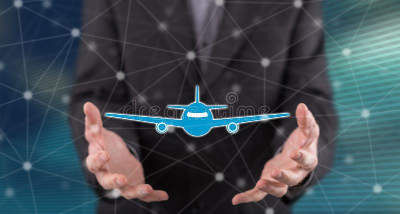 Concept of air transport. Air transport concept above the hands of a man in background royalty free stock photo