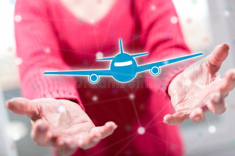 Concept of air transport. Air transport concept above the hands of a woman in background stock photos