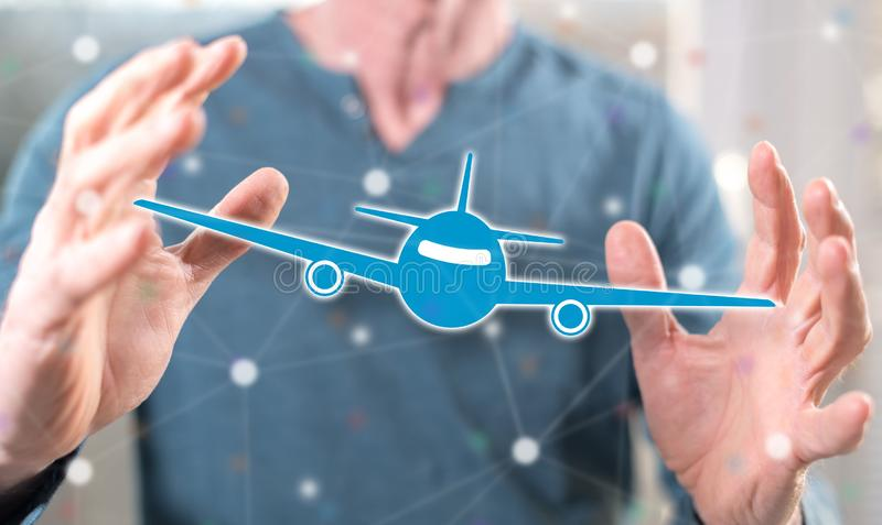 Concept of air transport. Air transport concept between hands of a man in background stock photos